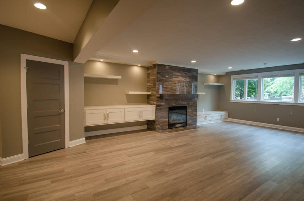 new basement remodel with fireplace
